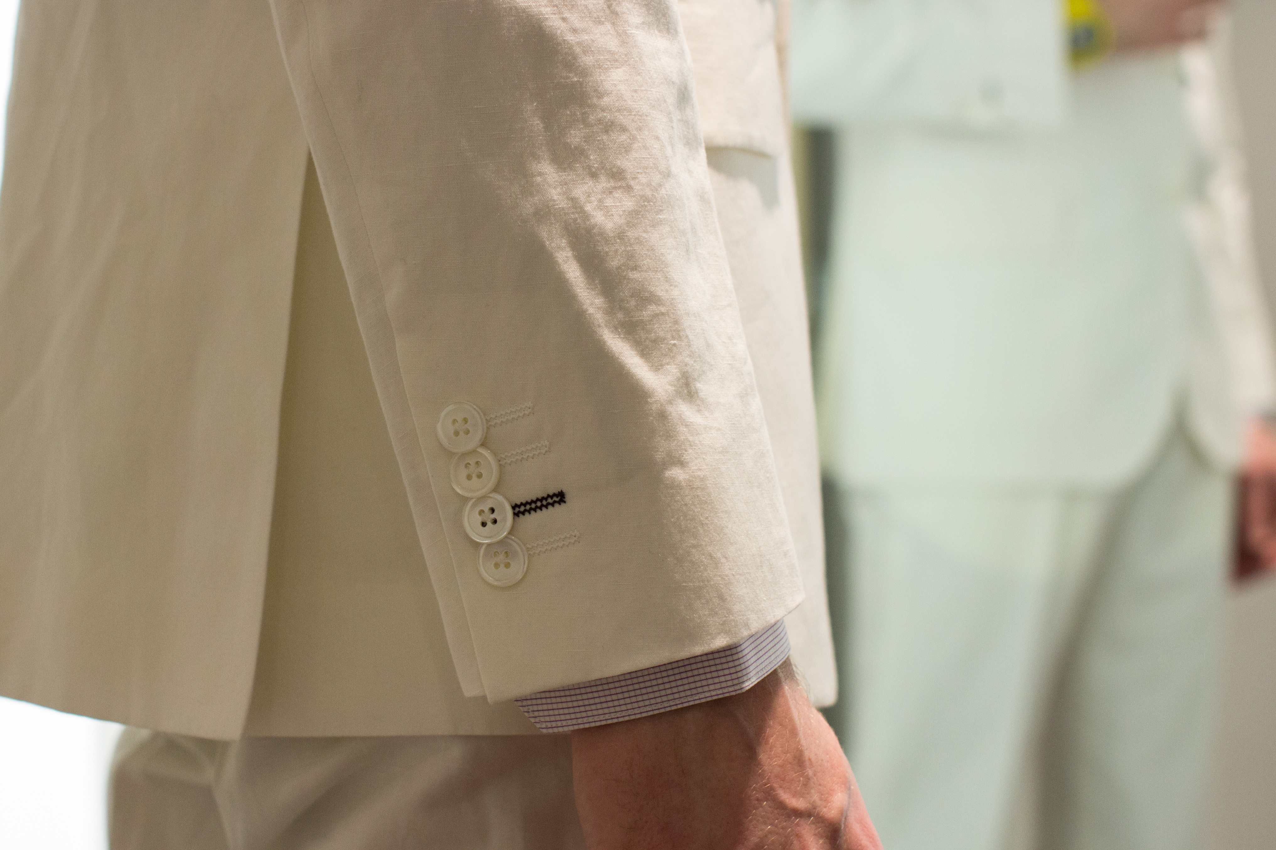 Cuff details on white linen suit at Paul Smith