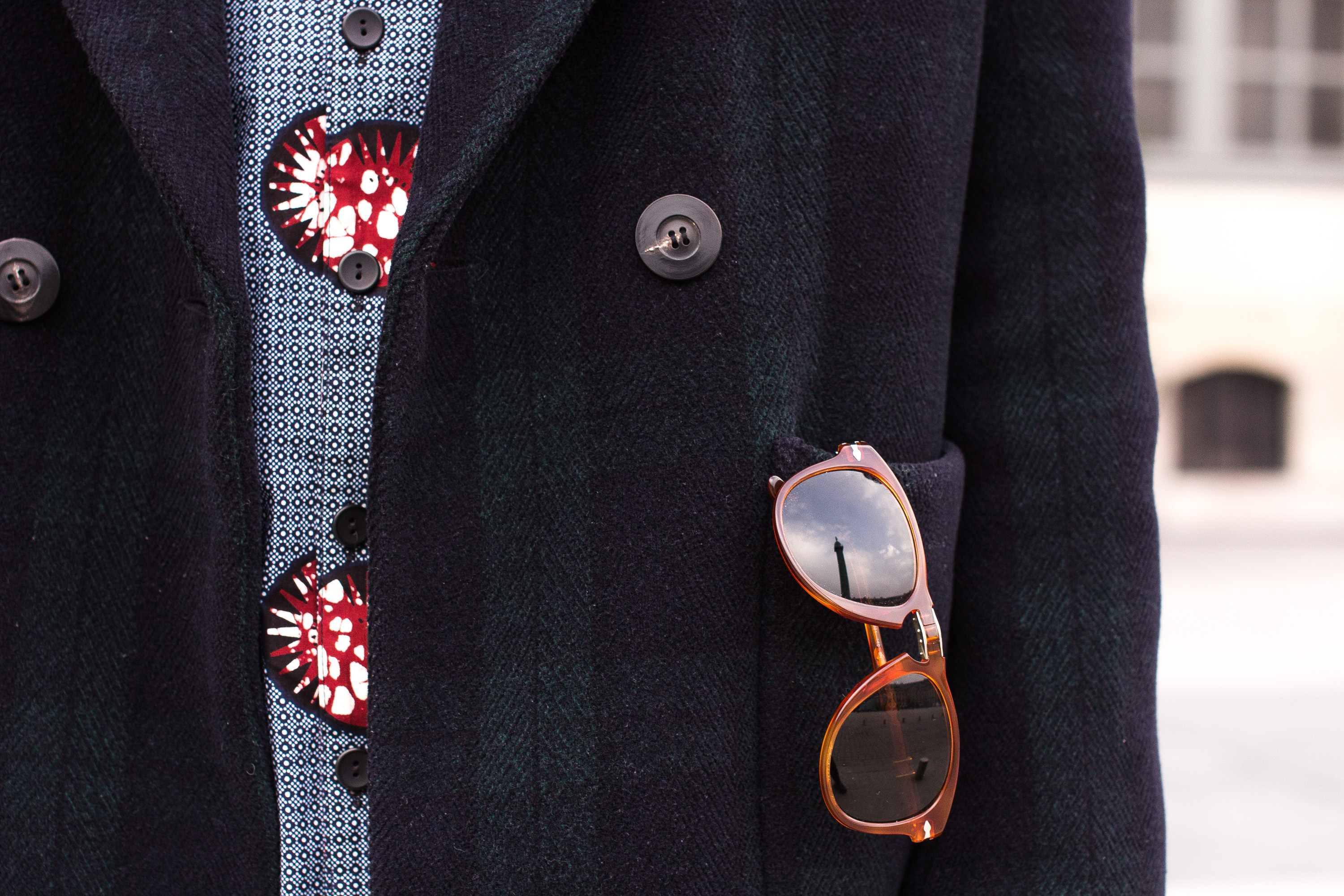 Patrons Woollen Coat details with Persol sunglasses